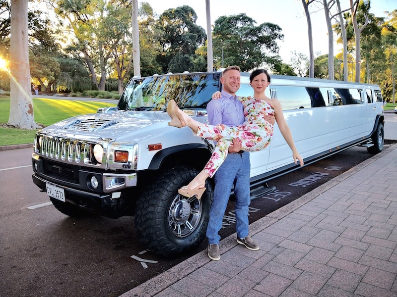 Guy holding his girlfriend in Kings Park during a Hummer Limos Perth hire service