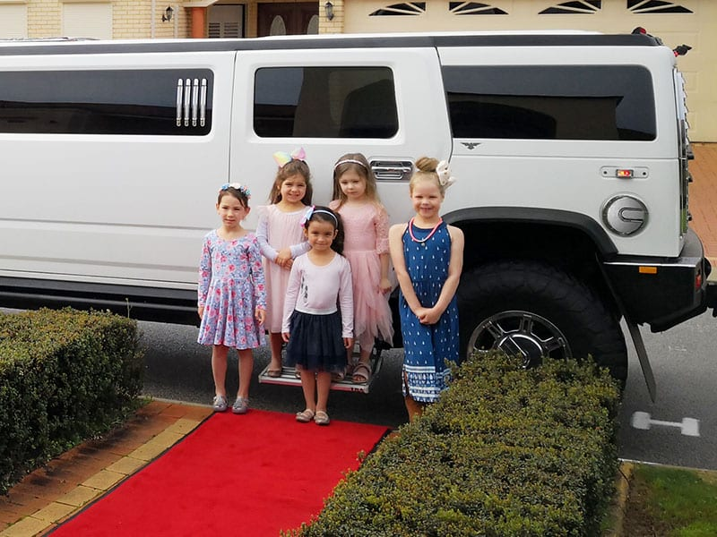 Hummer Limo Perth birthday party for kids and children standing on the Red Carpet
