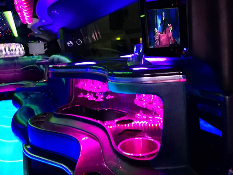 Pink, Blue and White Neon led lighting in the Hummer Limos party interior section inside the H2 Humvee