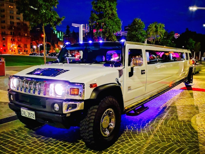 Hummer Limos Perth during a limo hire service at Barrack Street Jetty with the blue underbody neons on.